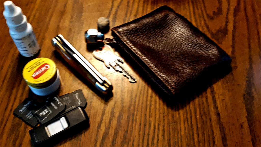 Most of the objects in my pouch. I actually carry several... Too embarrassed to mention in text.