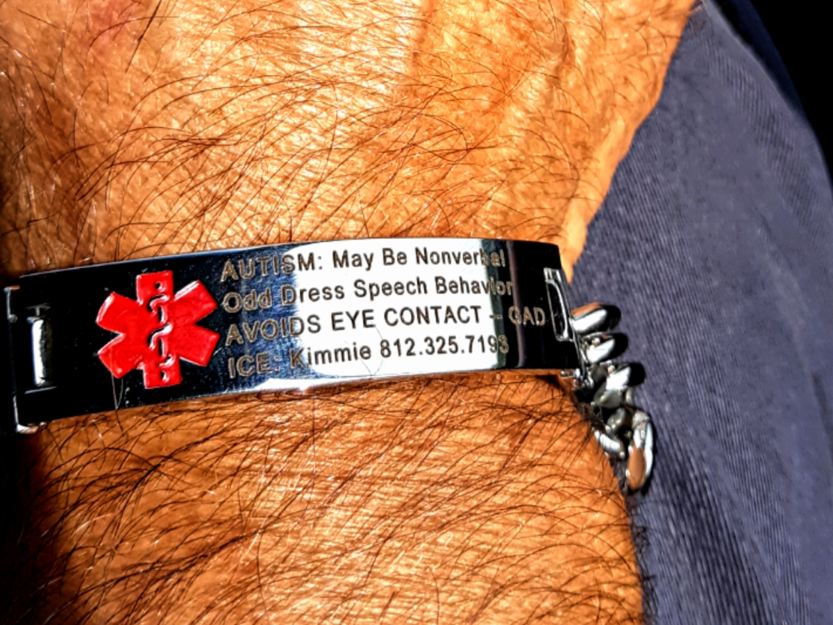 Photo of personalized Medical Alert bracelet that warns first responders that I'm autistic.
