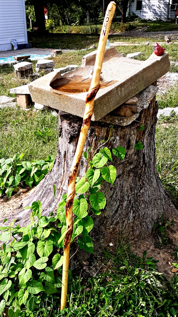 Photo of carved walking stick I carry I public. I exercise using it as a mini-quarterstaff for personal defense.