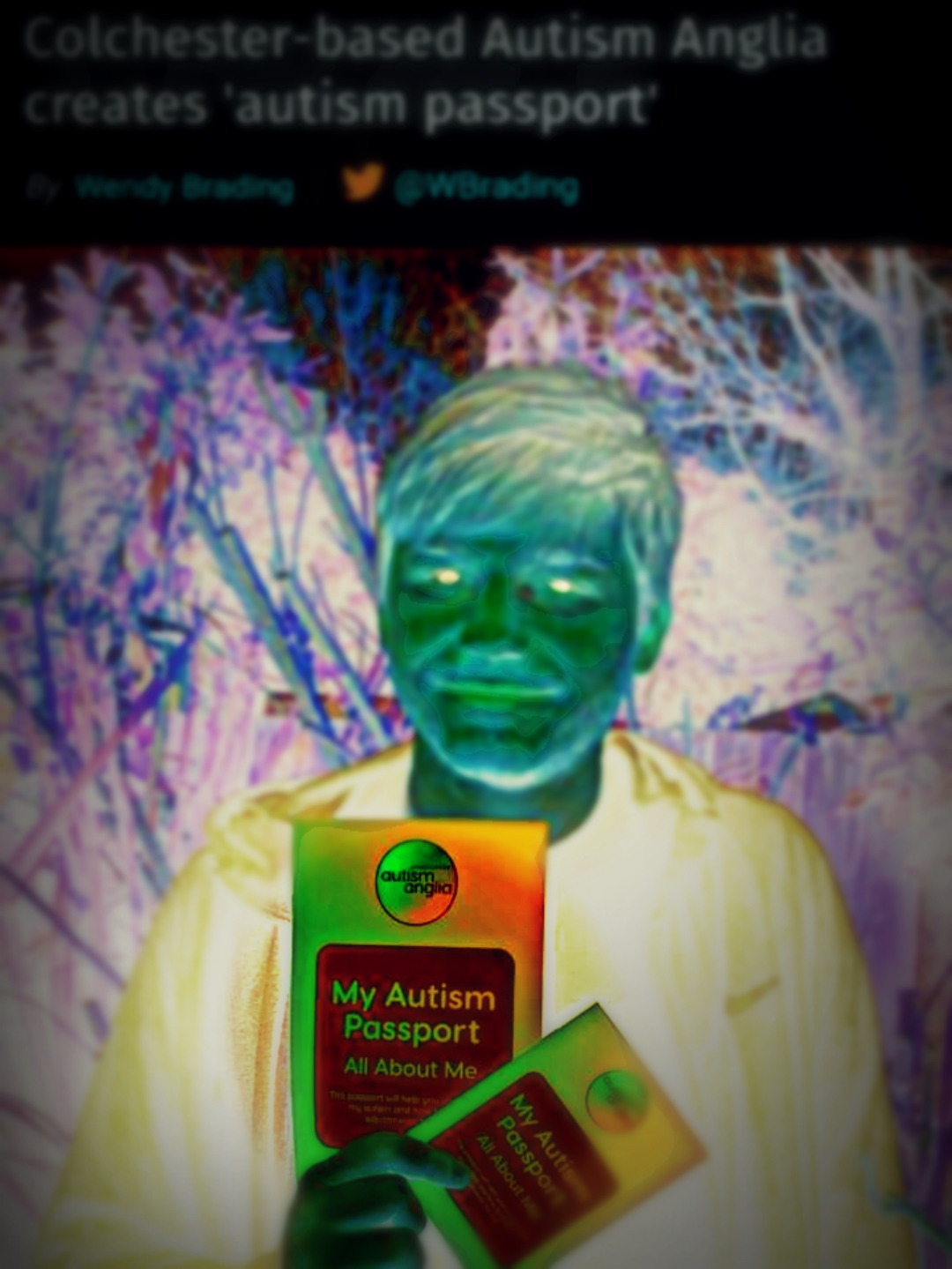 """Modified photo of photogenic young man holding a colorful """"Autism Passport,"""" from the Gazette News, """"Colchester-Based Autism Anglia Creates Autism Passport."""""""