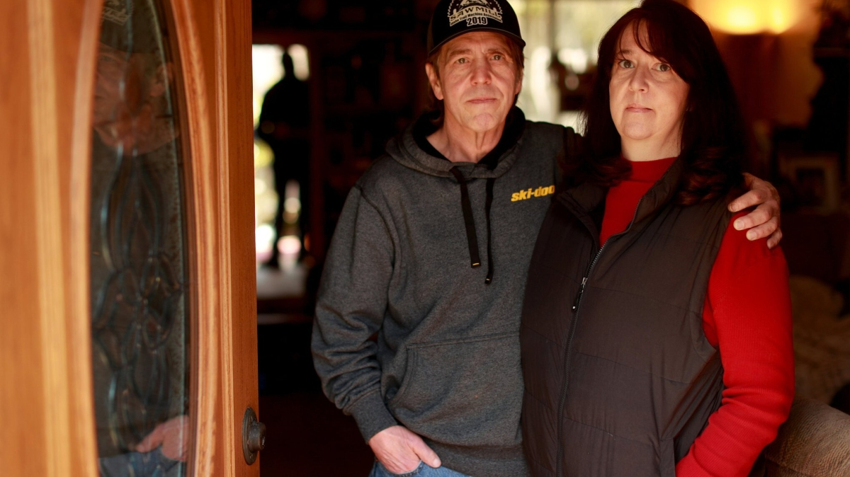 "Marc Ramsey and his wife Kellie Burlingham are photographed at their home in Bellevue on March 8. ""Hopefully the future brings more compassionate responses from the Bellevue PD on mental health visits to community members,"" says Ramsey. (Erika Schultz / The Seattle Times)"
