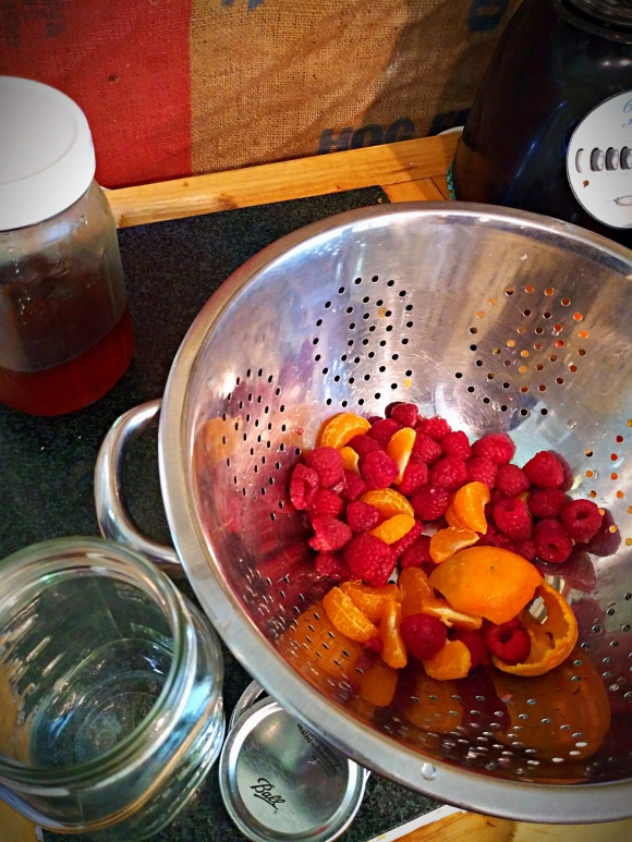Photo of rinsed & drained berries, oranges, and peels. Drained & ready to go.